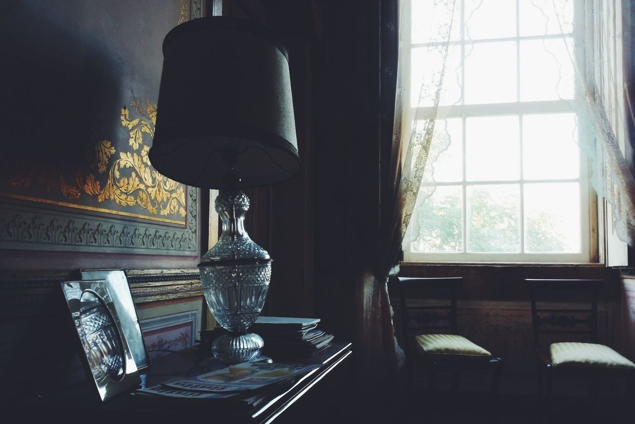 Antique lamp on sideboard at home