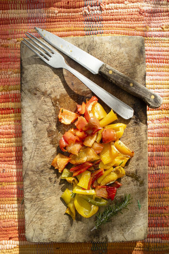 High angle view of meal served on cutting board