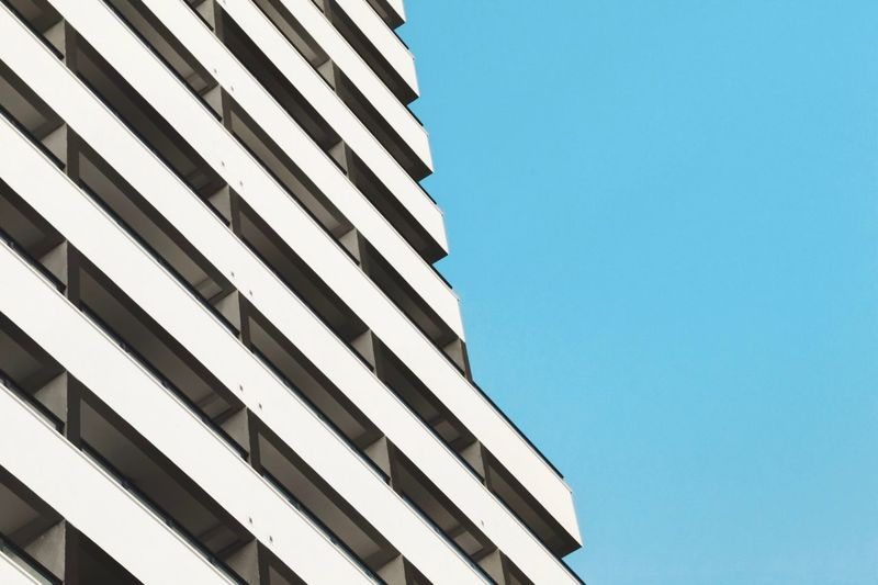 Lines And Shapes Urban Architecture Low Angle View Blue Built Structure Building Exterior Clear Sky Sky No People Copy Space Pattern Nature Day City Building Outdoors Window Modern Striped Office White Color The Architect - 2018 EyeEm Awards The Creative - 2018 EyeEm Awards #urbanana: The Urban Playground