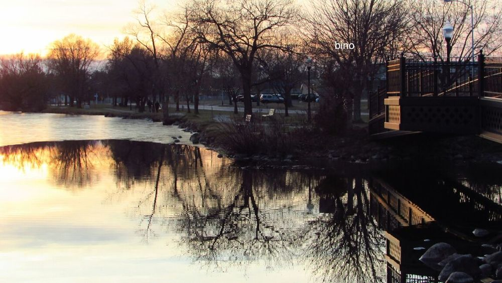 Walking At Dusk Around The Lake Bare Tree Chilly Weather Water Reflections Sunset Lake Cadillac Pure Michigan