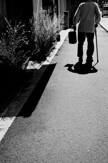 Sunlight Real People Shadow One Person Day Men Walking Rear View Street