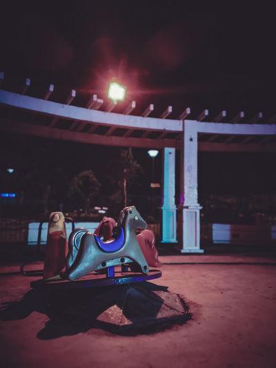 Eery Night Nightscape Street Streetlights Citylife Huaweip20pro PhonePhotography Streetdecoration Illuminated Arts Culture And Entertainment City Music Architecture Carousel Carousel Horses Street Scene