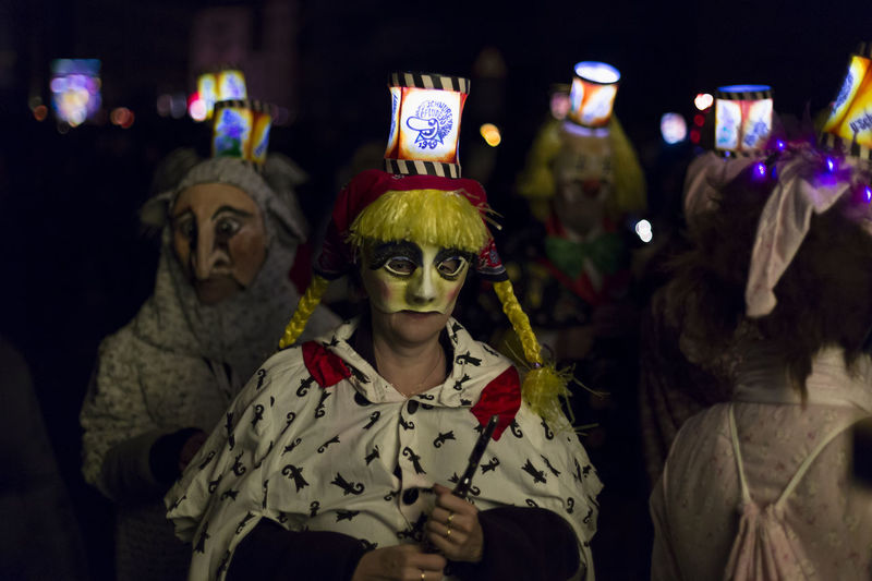 Schneidergasse, Basel, Switzerland - February 19th, 2018. Closeup of carnival participants wearing individual costumes with illuminated mask lanterns. Basel Carnival City City Life Lantern Music Tradition Woman Arts Culture And Entertainment Candid Close Up Close-up Colorful Focus On Foreground Group Of People Mask Night Parade Piccolo Portrait Real People Shrove Tuesday Swiss Switzerland Unesco
