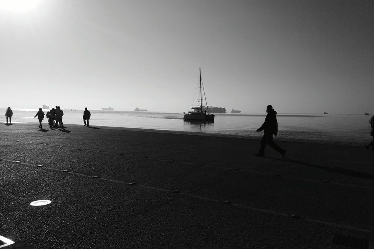 /Loners and drifters/ Blackandwhite Photography Bythesea Skg Natureinthecity Tranquility Greece Seaside People Watching Silhouettes Glitz Oneday Sailing Boat Nature Scenes Beautiful View Strangerthanparadise Winter Wonderland Noiretblanc Minimalism_bw BWlovers@ Thessaloniki Greece Showcase: December