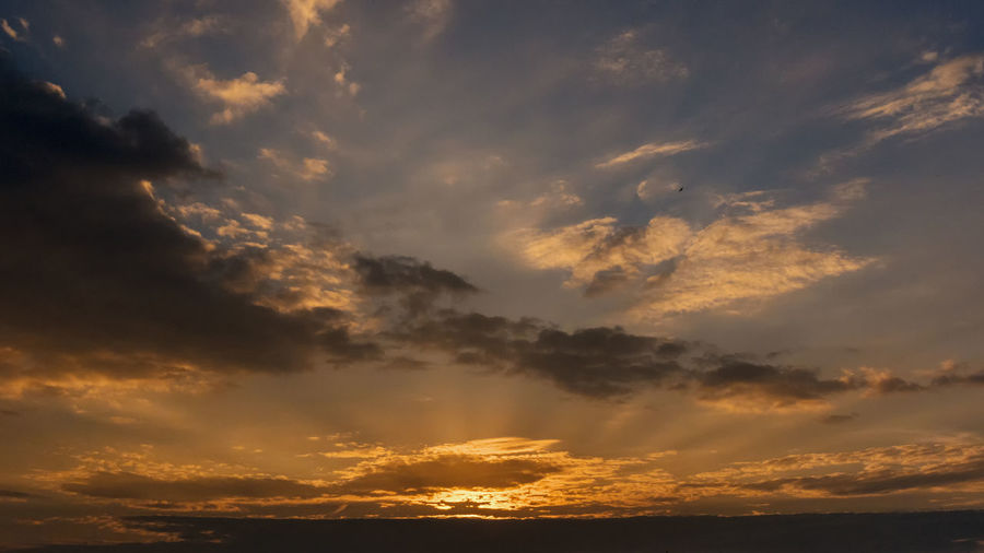 Wide skies Backgrounds Beauty In Nature Cloud - Sky Cloudscape Dramatic Sky Environment Idyllic Low Angle View Meteorology Nature No People Orange Color Outdoors Scenics - Nature Sky Sunbeam Sunlight Sunset Tranquil Scene Tranquility