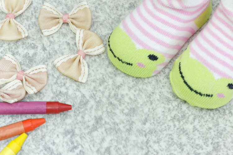 Children Kids Pair Of Socks Socks Copy Space Copyspace Ribbon Bow Cute Crayon Adorable Directly Above High Angle View Pattern Still Life Close-up Pair Canvas Shoe Footwear Fabric