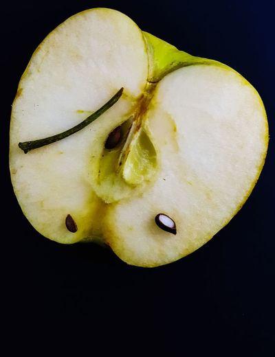 half ripe apple on dark background Fruit An Apple Keep A Doctor Away. Apple Half Apple Half Seed Stem Ripe Apple Vitamin Black Background Cross Section Close-up