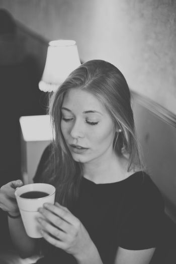 Beautiful Woman Holding Coffee Cup At Cafe