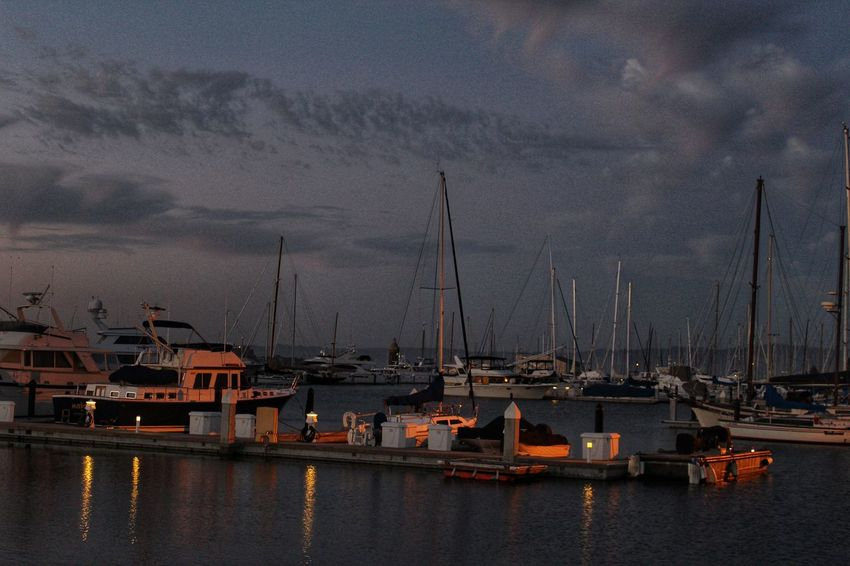 Boats on the harbor Dusk In The City Sunset Tranquility Ripples In The Water Nightsky Lights Lights And Shadows City Water Nautical Vessel Shipyard Harbor Sea Commercial Dock Urban Skyline Sky Mast Sailboat Pier Boat Waterfront Sailing Boat Dock Marina Yacht