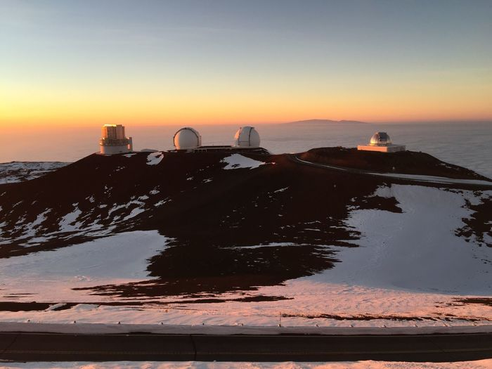 Observatory at mauna kea against sky during sunset
