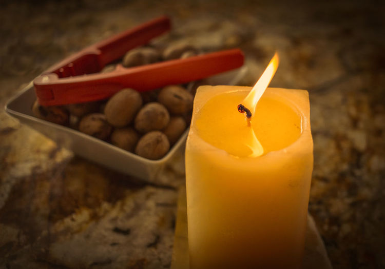 Close-up of lit yellow candle