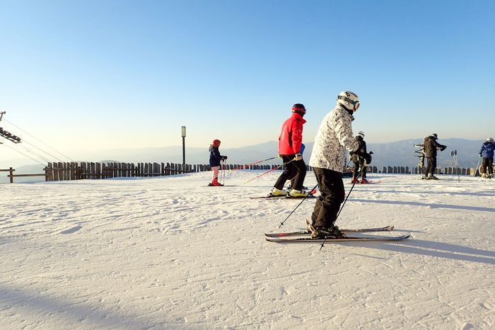 Snow Sports Winter Sunlight Cold Temperature Enjoyment Snow Young Adult Leisure Activity Vacations Outdoors Togetherness Friendship Bonding Winter Sport Winter Fun Skiing All Ready . Fun Times! Anticipation People Downhill Racing Mountain Winter Wear Mixed Age Range Eyeemphoto