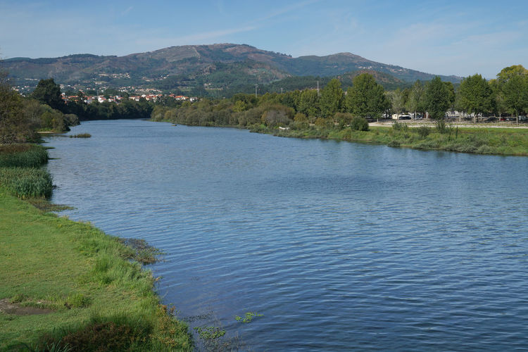 Rio Lima, Ponte de Lima, Portugal Bodies Of Water Panorama Ponte De Lima Portugal Water Reflections Beauty In Nature Countryside Day Europe Grass Idyllic Landscape Mountain Mountain Range Nature No People Outdoors River Scenics Sky Stream Tranquil Scene Tranquility Water Waterfront