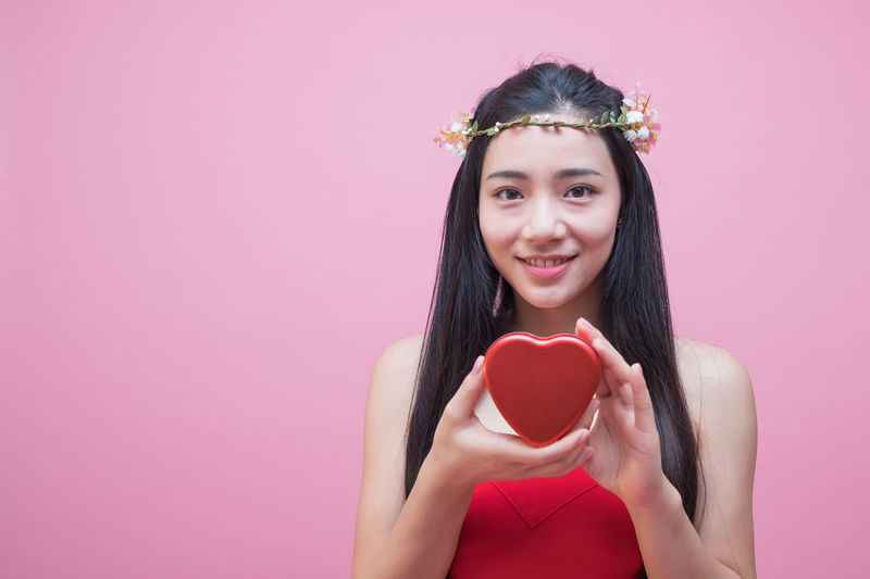 Adult Adults Only Beautiful Woman Cheerful Food And Drink Front View Happiness Heart Shape Holding Long Hair Looking At Camera Love One Person One Woman Only One Young Woman Only Only Women People Pink Background Pink Color Portrait Red Smiling Studio Shot Valentine's Day - Holiday Young Adult