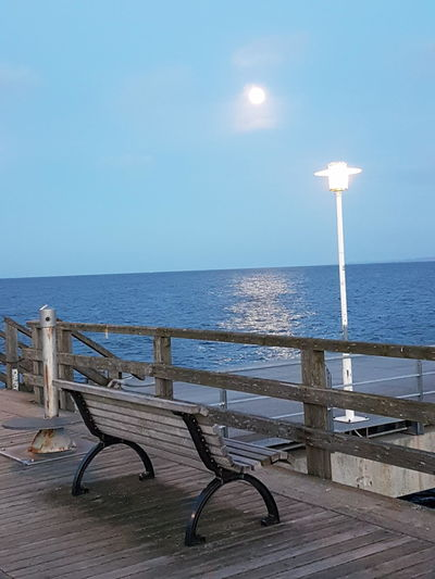 stillife at the sea bridge.. ..streetlight vs. Full moon😊😉 Sea Bridge Street Light Wood Light And Shadow Water Baltic Sea Winter Full Moon Night  Wintertime Cold Temperature Cold Harmony With Nature Tranquil Scene Idyllic Idyllic Scenery Colour Your Horizn