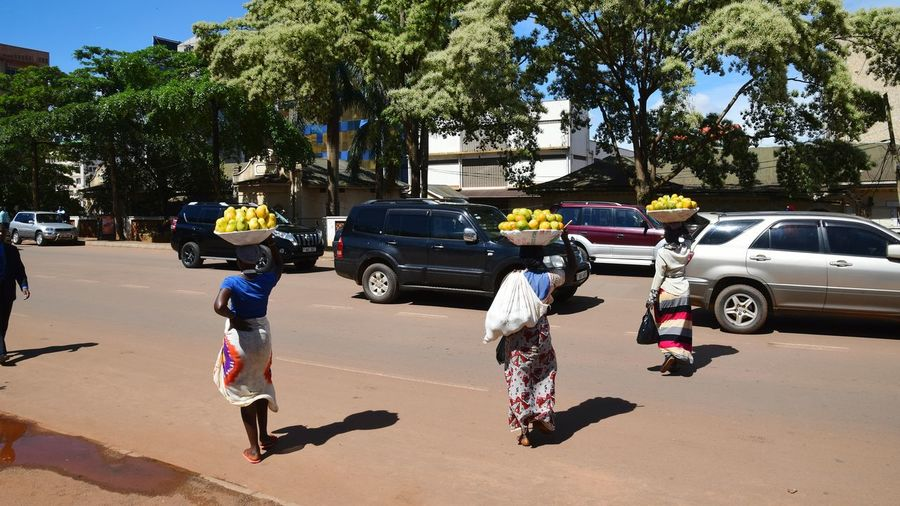 Street Stretphotography Women Fruits Mango Fruit Working Working Women Tree Togetherness Full Length Car Land Vehicle Shadow Sky Adventures In The City