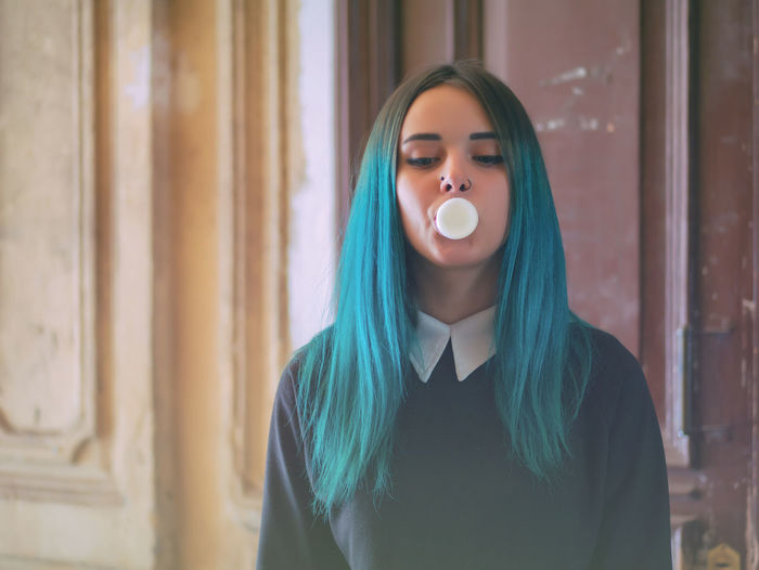 Hipster Blowing Bubble Gum