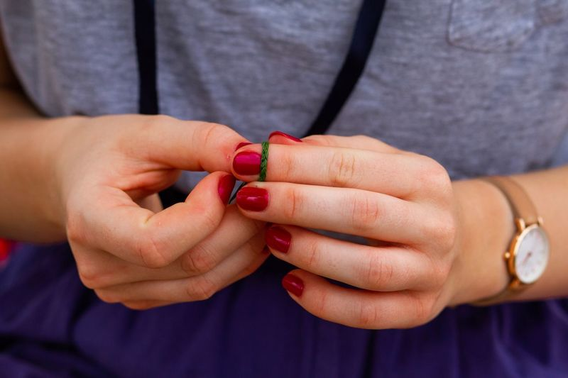 Midsection Of Woman With Red Painted Fingernails