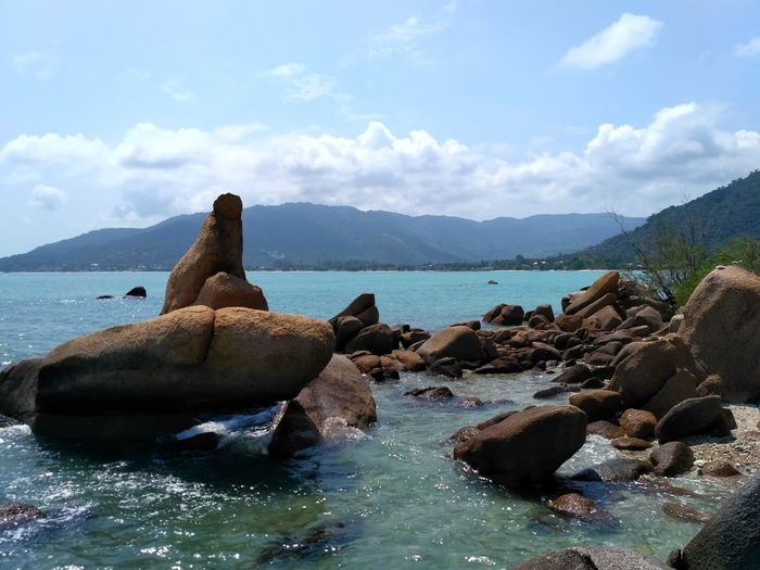 Ko Samui, Thailand Sea Beach Rock - Object Nature No People Tranquility Landscape Water Sky Beauty In Nature Sea Life Archipelago Sea And Sky Cloud - Sky Tranquility Rocky Mountains Stone Vacations Day Wave Beauty In Nature Nature Horizon Over Water Close-up Tranquil Scene