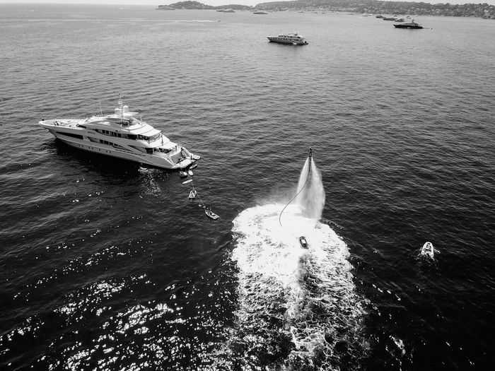 DJI shot of flyboard Flyboard Flyboarding Dji DJI Mavic Pro DJI X Eyeem DJI Mavic Pro Drone  Dronephotography Drone Photography Droneshot Drones Blackandwhite Black And White EyeEm Gallery EyeEm Nature Lover Outdoors Landscape Black & White Aerial France Naturelovers Traveling Beauty In Nature Travel Water Nautical Vessel Sea Wake - Water High Angle View Boat