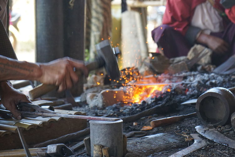 Making a knife Blacksmith  Burning Close-up Day Flame Food Food And Drink Heat - Temperature Holding Human Body Part Human Hand Low Section Men Metal Industry Motion Occupation Outdoors People Preparation  Real People Women Working