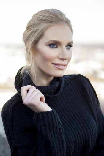 Close-Up Of Beautiful Woman Wearing Black Turtleneck