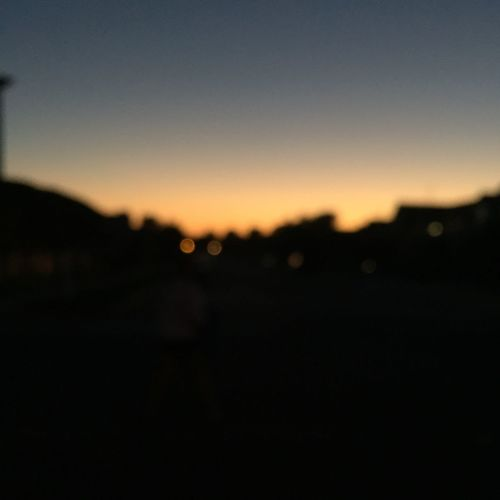 Silhouette Defocused Sunset Clear Sky Sky Tranquil Scene Blurred Focus On Foreground Dark Tranquility Outline Calm Blue Nature Scenics Outdoors Beauty In Nature Majestic No People