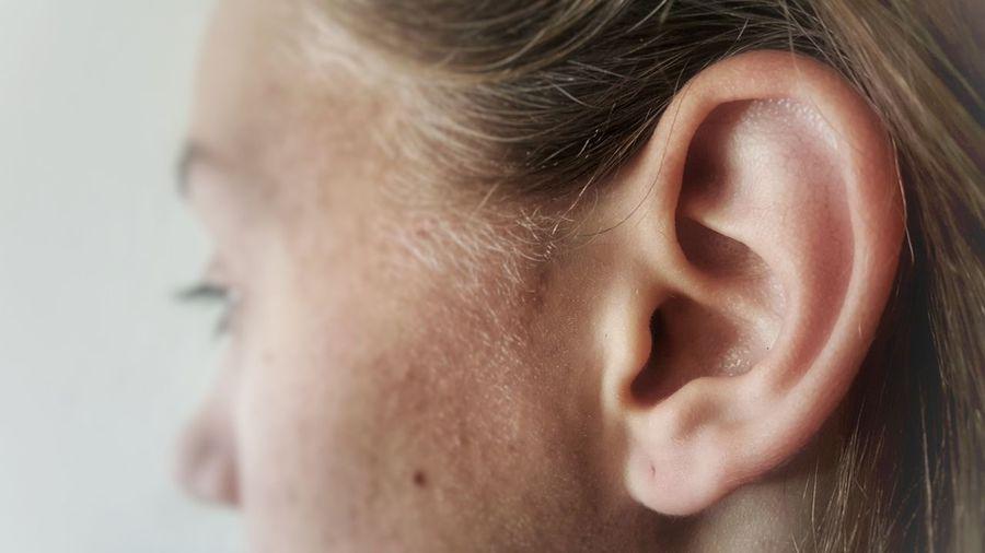 Cropped image of teenage girl ear