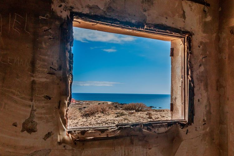 Old natural framing EyeEm Selects Window Sea Water Sky Day Nature Beach No People Horizon Over Water Sunlight Indoors  Beauty In Nature Scenics Architecture Close-up