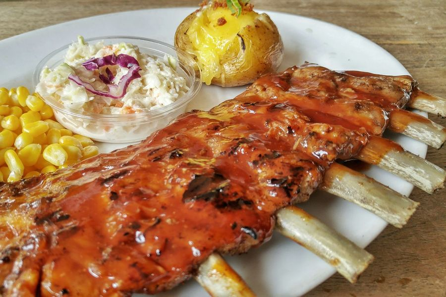 Delicious pork ribs Food Porkribs Baked Potato Grill Dine Delicious Yummy Lunch Restaurant Grilled Meat