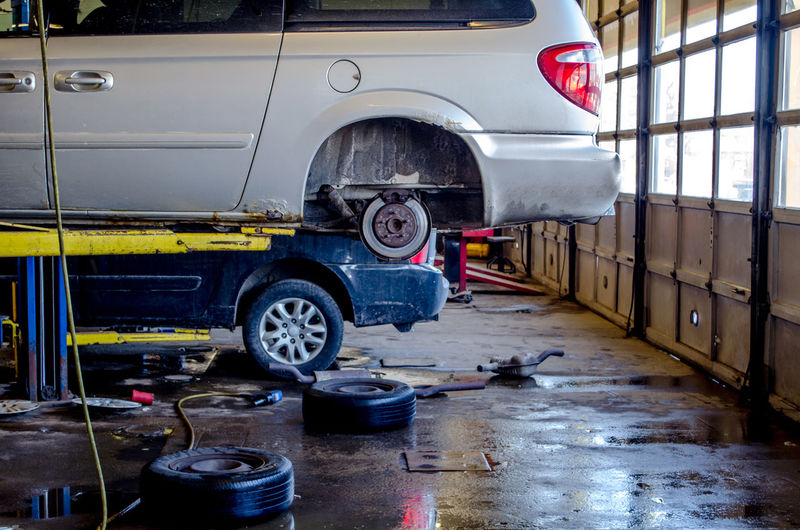 Working on repairing vehicles in an auto repair shop