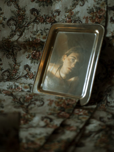 It's not enough to look at yourself. you have to look inside. mysterious reflection of a young woman