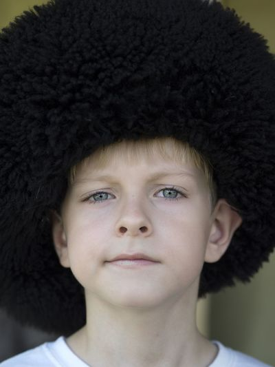Close-Up Portrait Of Boy Wearing Uniform Hat At Event