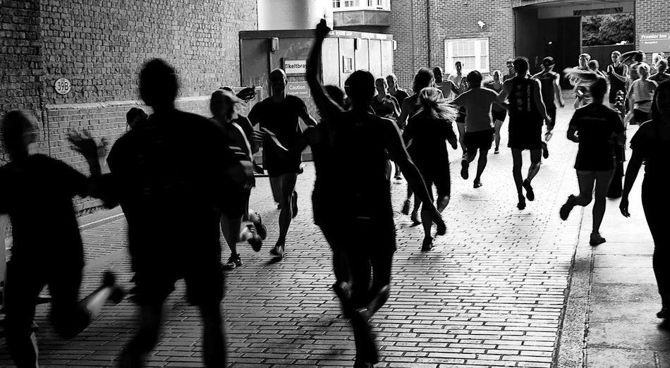 People running on street in city during marathon