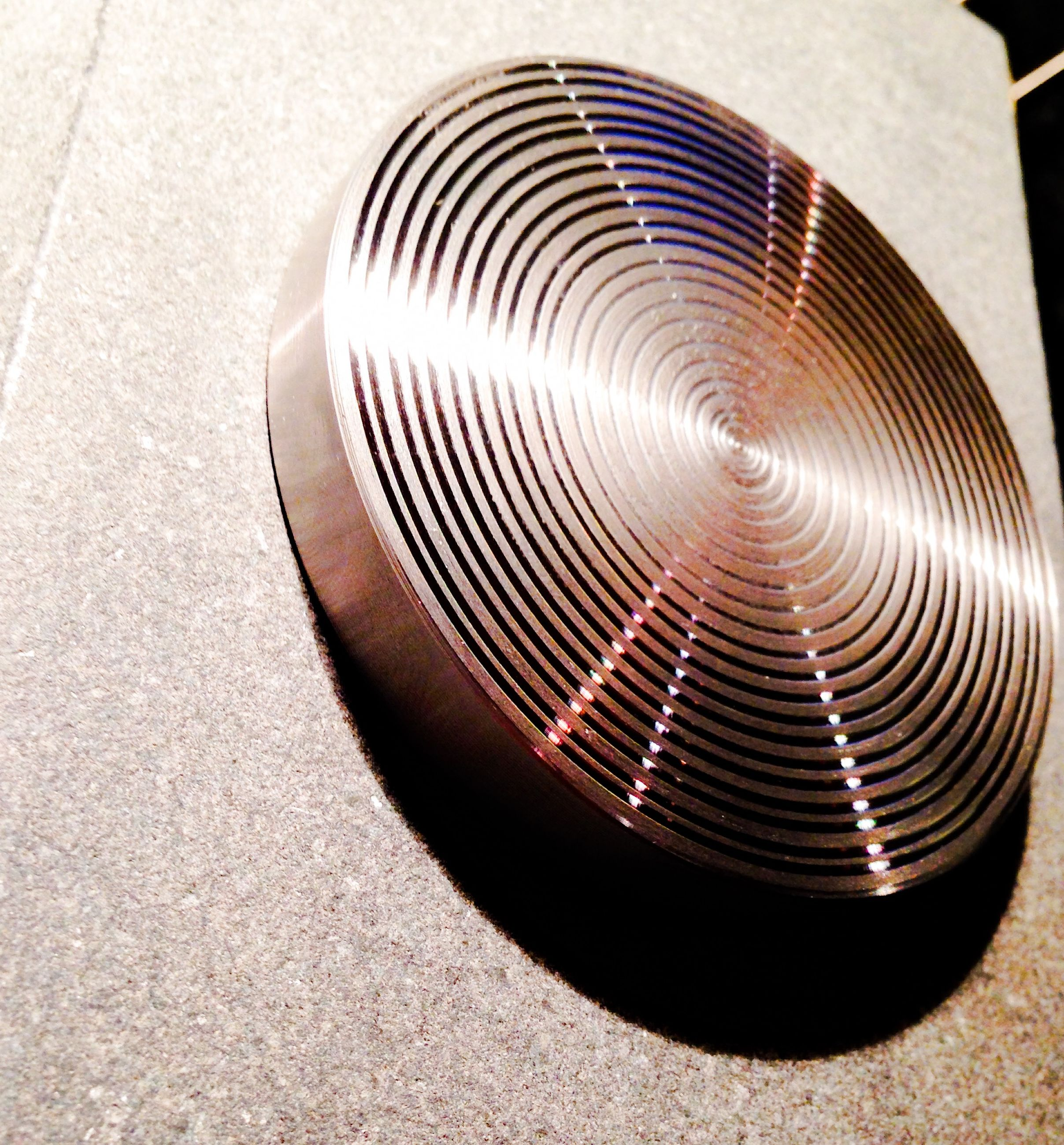indoors, high angle view, still life, circle, close-up, pattern, no people, metal, street, spiral, empty, single object, shape, in a row, metallic, absence, shadow, curve, day, table