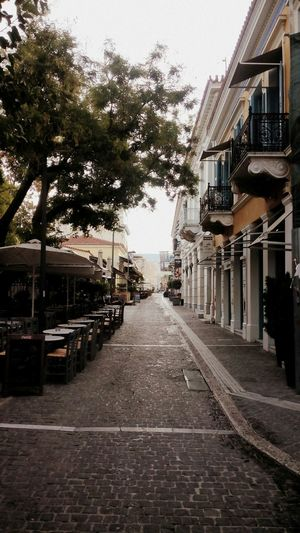 Stone Masonry Early Morning Tables And Chairs Trees Coffee Shops Street Photography Old City Streets Green Discover Your City Urbanexploration