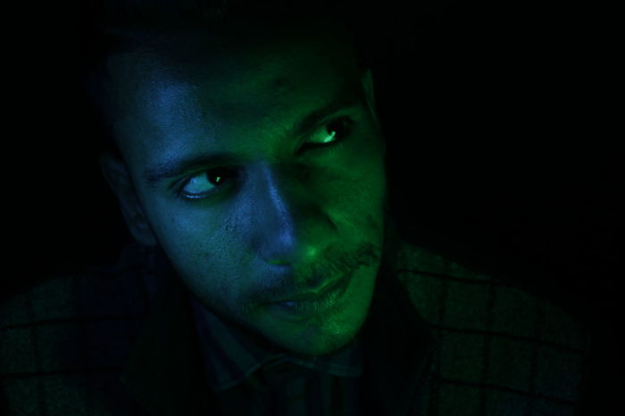 cinematic Photography Nightphotography Cinematic Serious Light And Shadow Light In The Darkness Green Blue AI Now! Dark Green Color Adults Only Spooky Adult Human Body Part Portrait One Person Night Looking At Camera Only Women People Evil Futuristic Illuminated EyeEm Ready