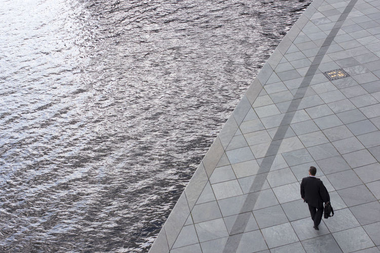 High angle view of man standing in water