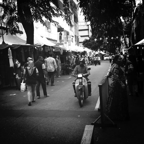 The Street Photographer - 2014 EyeEm Awards i wandering Kuala Lumpur in the evening looking to kill time. From my mobile phone. This street are closed for temporary Bazaar during the Ramadan  month