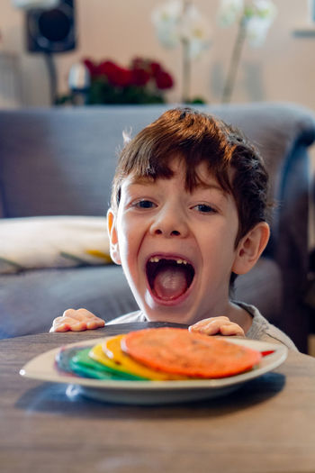Portrait of boy with  pancakes in plate