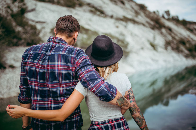Couple enjoying vacation on the lake Couple Hiking Love Beauty In Nature Bonding Couple - Relationship Happiness Heterosexual Couple Lake Lifestyles Outdoors Togheter Two People Young Adult Young Couple