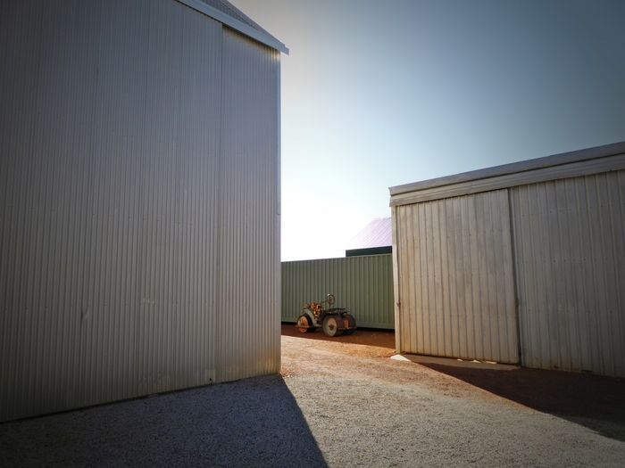 Architecture Building Exterior Built Structure Corrugated Iron Day Factory Hot Temperatures Industry No People Old Tractor Outdoors Sunlight Sunlight And Shadow Sunny Day Tin Sheds Warehouse