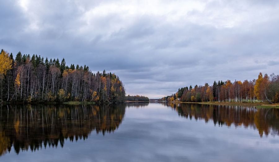 Reflection of trees on lake against sky during autumn