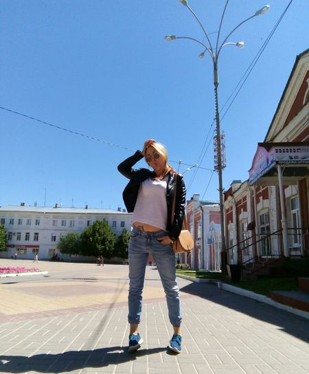 Young Women Girl Blond Hair Pose Posing Summertime Pretty Jeans Street Fashion Glasses Sunlight Summer Leather Jacket Full Length Clear Sky City Standing Front View Blue Sky Casual Clothing Building