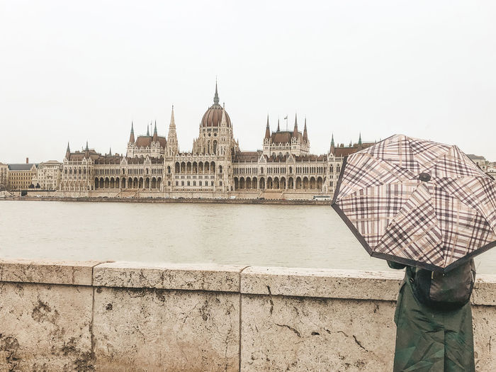 Budapest parliament building Built Structure Architecture Building Exterior Sky Water Travel Destinations Tourism City Travel River Nature Real People The Past Budapest Hungary Budapest Parliament Umbrella Europe Trip