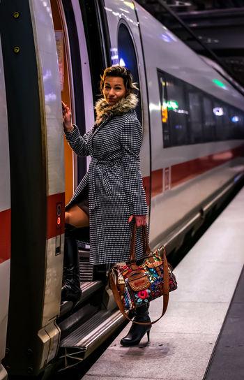 Portrait of woman entering train