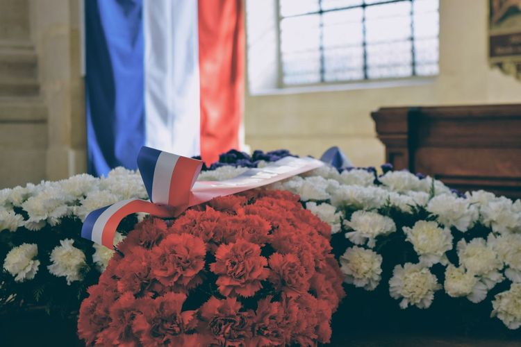 Close-up of flower bouquet with french flag background