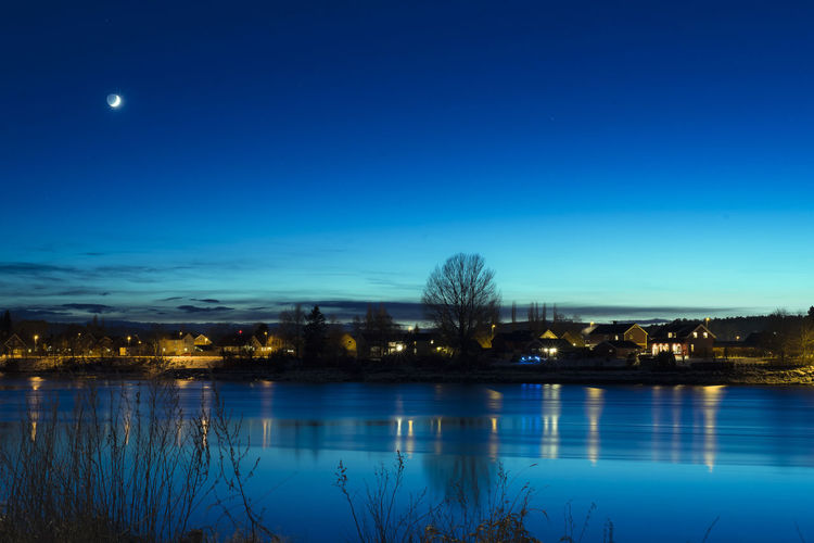 Architecture Beauty In Nature Blue Building Exterior Clear Sky Illuminated Lake Moon Nature Night No People Outdoors Reflection Scenics Sky Tranquil Scene Tranquility Tree Water Waterfront