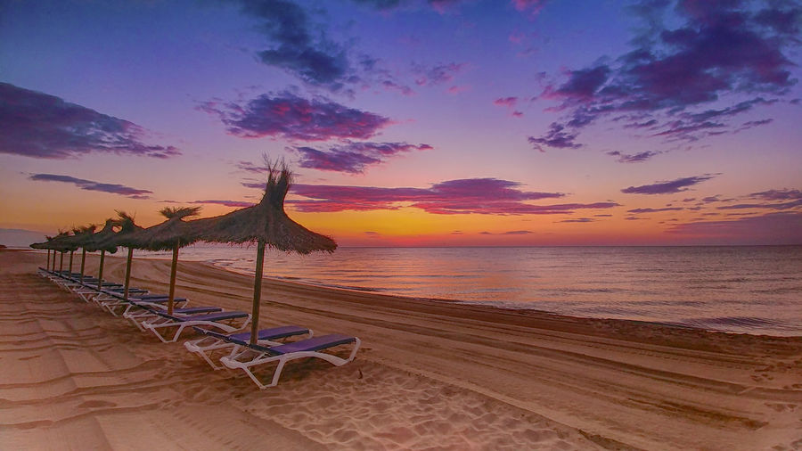 France Beach Beauty In Nature Chair Cloud - Sky Horizon Horizon Over Water Idyllic Land Nature No People Orange Color Outdoors Sand Scenics - Nature Sea Sky Sunset Tranquil Scene Tranquility Umbrellas Water