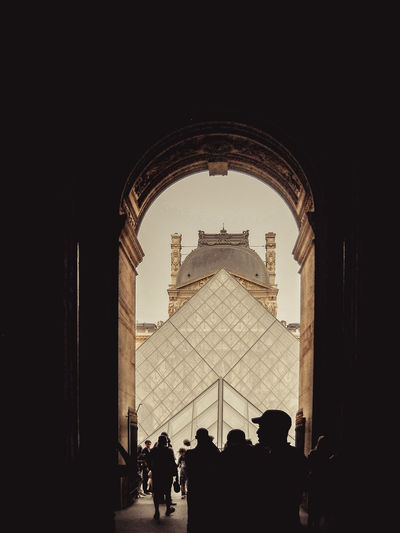 Silhouette of people at historical building
